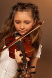 One girl playing the violin on gel background Royalty Free Stock Photo