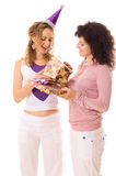 One girl presenting to another birthday gifts Stock Images