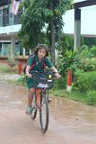 One girl is riding a bicycle. stock image