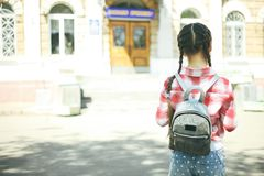 Schoolgirl with a schoolbag Royalty Free Stock Photo