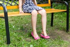 One girl sitting alone on bench waiting royalty free stock photos