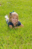 One girl sitting in grass Royalty Free Stock Photo