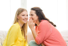 One girl telling another secret Royalty Free Stock Image