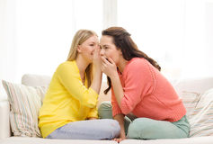 One girl telling another secret. Friendship, gossip and happiness concept - one girl telling another secret royalty free stock photos