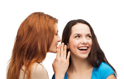 One girl telling another secret Stock Images