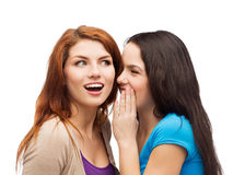 One girl telling another secret Stock Photos