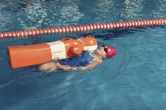 One Girl with Training Dummy in a Pool. One Girl with Training Dummy in an Old School Pool Stock Photo