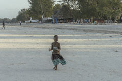One girl on Zanzibar beach royalty free stock photo