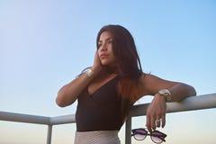 One glamur girl. In sunset light on balcony sky background Stock Photography