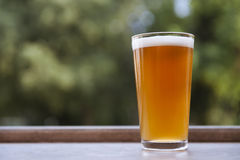 One glass of beer on the terrace. Glass of Weissbier (Wheat beer Stock Image