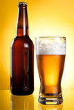One glass and Bottle of fresh light beer Royalty Free Stock Image