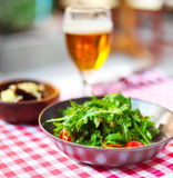 One glass of light beer with salad Royalty Free Stock Images