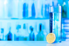 One glass of mineral water with lemon slice at bar Royalty Free Stock Image