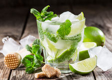 One glass of mojito cocktail with fresh lime Stock Photos