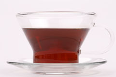 One glass teacup. With black tea, close up Royalty Free Stock Images