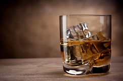 One glass of whisky. On a wooden table Stock Photography