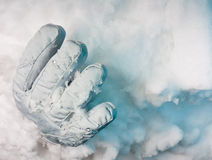 One glove sticking out of a snowdrift Royalty Free Stock Image