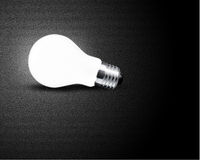 One glowing Light bulb. On black background Royalty Free Stock Photos