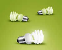 One glowing Light bulb. From three Light bulb idea on green background Stock Photo