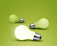 One glowing Light bulb. From three Light bulb idea on green background Royalty Free Stock Image