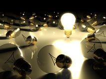 One glowing light bulb amongst other light bulbs Royalty Free Stock Photography