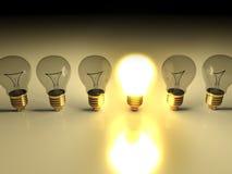 One Glowing Light Bulb Amongst Other Light Bulbs Stock Photo