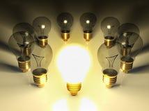 One Glowing Light Bulb Amongst Other Light Bulbs Stock Photos