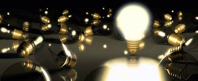 One glowing light bulb amongst other light bulbs Royalty Free Stock Images