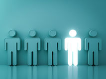 One glowing light man standing among green people on green background Royalty Free Stock Photo