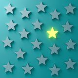 One glowing star standing among other dim stars on dark blue green pastel color wall background. Stand out from the crowd and different creative idea concepts royalty free illustration