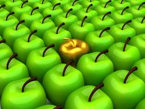 One gold apple among background of green apples Royalty Free Stock Photos