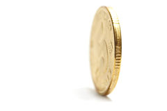 One Gold Coin Standing Stock Photo