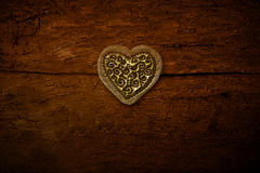 One gold hearts on old wooden background Royalty Free Stock Photo