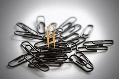 One gold and some black clips Royalty Free Stock Images