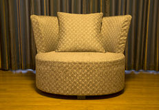 One golden chair cushion Stock Photography