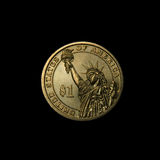 One golden dollar. A one dollar coin of America, isolated in black Royalty Free Stock Images