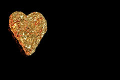 One golden heart on left side. Royalty Free Stock Photography