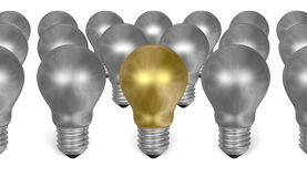 One golden light bulb among many silver ones Royalty Free Stock Photos