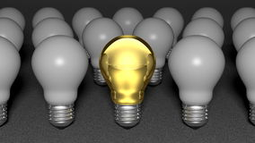One golden light bulb among many white light bulbs Royalty Free Stock Photos