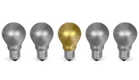 One golden light bulb in row of many silver ones. Front view Royalty Free Stock Images