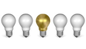 One golden light bulb in row of white ones. Front view Royalty Free Stock Photography