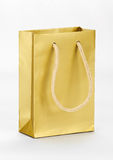 One golden shopping bag. Royalty Free Stock Images
