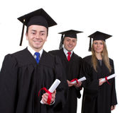 One graduate leading two others, isolated on white Royalty Free Stock Images