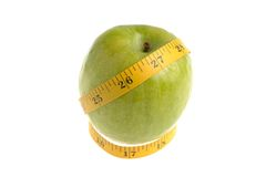One green apple with measuring tape isolated. On white background Stock Photos