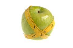 One green apple with measuring tape isolated. On white background Stock Photo