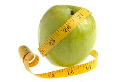 One green apple with measuring tape isolated. On white background Royalty Free Stock Photo