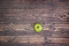 One green apple on the table.  stock image