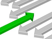 One green arrow against gray arrows Stock Photo