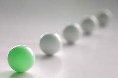 One Green Ball. One colour, green and white balls Stock Image