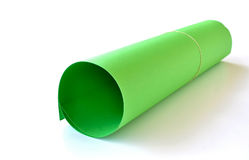 One green cardboard. A green cardboard paper rolled and wrapped with a rubber Royalty Free Stock Photography